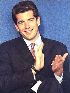 John F. Kennedy Jr. smiles and applauds as he sits onstage in this file picture from the May 29, 1998 John F. Kennedy Profiles in Courage Award ceremonies at the JFK Presidential Library in Boston. (Reuters)