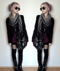 layered on top over a dress, with thin tights, long socks and platform boots