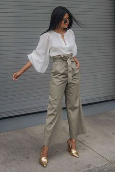 Your Guide To Wearing Neutral Colors This Spring: Fashion blogger 'Walk In Wonderland' wearing a white puff sleeve blouse, khaki belted culottes, metallic heels and round sunglasses.
