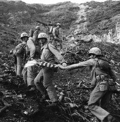 Walking the original flag to the top of Iwo Jima