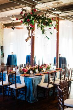 hanging centerpiece - photo by Casto Photography http://ruffledblog.com/whimsical-engine-room-wedding