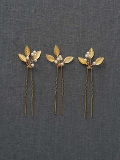 Adele Hairpin: Rose Gold Rose gold hairpins are handspun with tiny leaflets and pearls. These delicate hairpieces tuck beautifully into a