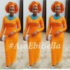 Nigerian wedding styles, Nigerian Aso-ebi styles. Ore-iyawo styles. Orange Guipure lace Iro and Buba. Orange Gele. Turquoise Blue jewelry.