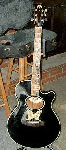 Epiphone version of the Orville Gibson guitar celebrating the 90th anniversary. Could have, should have been better.