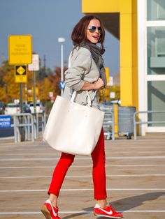gray sweater with red jeans and red sneakers