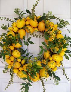 I love having our Christmas wreath in yellow lemons. Some people like pine cones? I like lemons......