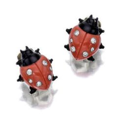 A pair of art deco coral, diamond and enamel ladybug earclips, Cartier, French, circa 1925 each with a coral body, enhanced with circular-cut diamonds, with black enamel head and legs; signed Cartier, Paris, no. 0053 (indistinct) length: 1 5/8in