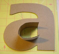 I love a good monogram! DIY cardboard letters, covered in fabric. [This pin description was written by Libbi Diane Flynn]