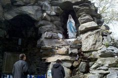Collect holy water from a Bronx grotto