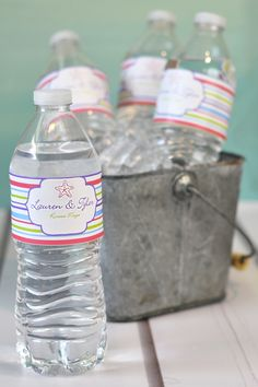 Party Drink Station Idea - Wrap your bottle water in waterproof vinyl plastic water bottle labels personalized with a fun design, the celebrant's name and event date for a unique accent to any party theme.