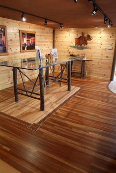 Interior Room - 4-inch, 6-inch and 8-inch knotty pine tongue & groove and matched paneling. Prefinished mountain Cherry hardwood floor with center birdseye maple.