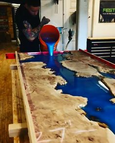 Super cool mesmerizing resin pour with mica powder pigment = One very nice river. - Epoxy - Super cool mesmerizing resin pour with mica powder pigment = One very nice river table! Wood Table Rustic, Epoxy Wood Table, Wood Table Design, Epoxy Resin Table, Epoxy Resin Art, Rustic Design, Design Design, Diy Epoxy, Resin Countertops