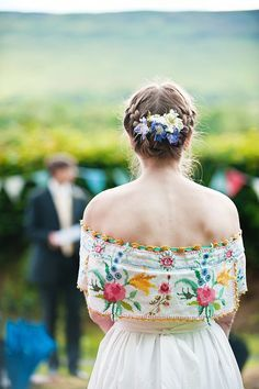 A Wedding Dress of Embroidered Vintage Table Cloth for a Bride With Flowers In Her Hair