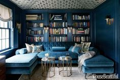 """Because the library is small, it lent itself to a rich jewel-box treatment,"" designer Jeannette Whitson says about this Nashville house. Woodwork is painted a deep, saturated color, Farrow & Ball's Hague Blue, and the ceiling is tented with a Michael S. Smith Indian block fabric, Jasper."