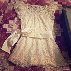Creamy lace tunic w/ satin belt Beautiful top. Worn a couple of times. Has satin camisole underneath and satin belt Charlotte Russe Tops Tunics
