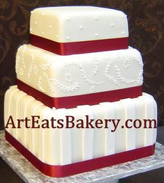 Three tier square fondant wedding cake with red ribbons, dots, stripes and leaf pattern  royal icing picture by arteatsbakery, via Flickr