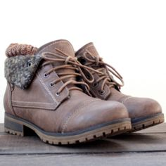 Adorable cozy boot sock detailing adorns these taupe booties. Featuring a laced up front, side button snaps gives the ability to wear the booties folds up or down, and rugged soles for no slippage. Co