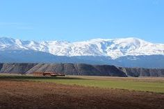 """Granada, Aldeire, Minas de Alquife    37° 12' 36.75"""" N  3° 4' 5.05"""" W  Cortesía de José Ángel de la Peca.  Los restos de la antigua explotación minera se localizan en la vertiente Norte de Sierra Nevada y en el extremo meridional de la llanura diluvial del Marquesado del Zenete, constituido por los 10 municipios que ocupan la zona Sur de la comarca de Guadix. Cesó la actividad minera en 1996."""