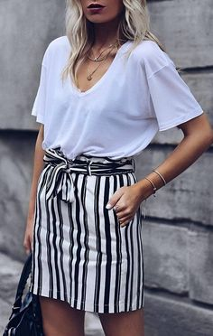 stylish look white top stripped skirt bag