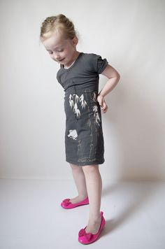 mini dress out of an adult shirt. Explains how to make the neck line smaller without looking dumb.