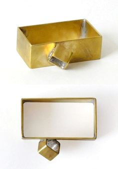 Laminated and brass rings above by UK designer Konstantinos