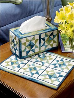 """Stitch a tissue set featuring an old-time favorite quilt design. Size: Tissue topper: Covers a family-size tissue box. Place Mat: 10 1/2"""" x 13 1/4"""". Made with medium (worsted) weight yarn and 7-count plastic canvas. Skill Level: Beginner"""