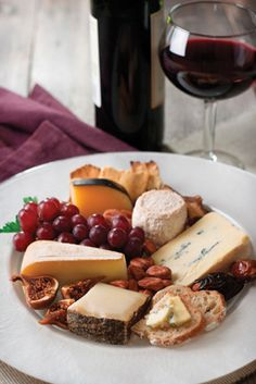 For at home date nights - Cheese plate including 1 soft, 1 medium and 1 hard cheese, fruit, bread and jam and of course, wine! #alwaysawinner