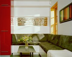 LOVE this idea - can put in a half wall in dining room build angled bench seating and add a table....