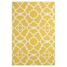 Add a pop of pattern to your living room or den with this stylish hand-hooked wool rug, showcasing a geometric trellis motif in yellow and white.