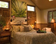 Tropical themed guest bedroom by JRML