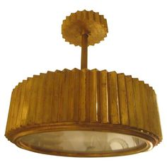 Custom Giltwood Hand-Carved Fixture in the Art Deco Manner | From a unique collection of antique and modern chandeliers and pendants at https://www.1stdibs.com/furniture/lighting/chandeliers-pendant-lights/