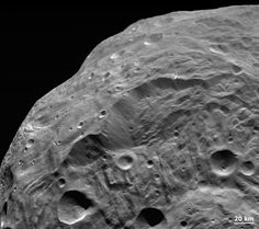 A Landslide on Asteroid Vesta (Nov 28 2011)  Image Credit: NASA, JPL-Caltech, UCLA, MPS, DLR, IDA Asteroid Vesta is home to some of the most impressive cliffs in the Solar System. Pictured above near the image center is a very deep cliff running about 20 kilometers from top to bottom. The image was taken by the robotic Dawn spacecraft that began orbiting the 500-kilometer space rock earlier this year. The topography of the scarp and its surroundings indicates that huge landslides (...)…