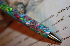 Marble Polymer Clay Click Pen Pink Purple Green. $9.00, via Etsy.