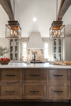 Natural wood accents bring warmth to this stunning kitchen. Rustic Kitchen Island, Build Kitchen Island, Rustic Kitchen Cabinets, Farmhouse Kitchen Light Fixtures, Cheap Kitchen Islands, Farmhouse Dining Room Lighting, Kitchen Countertops, Farmhouse Kitchens, Dark Cabinets
