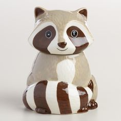 Our exclusive ceramic sugar keeper is shaped and painted like a raccoon, complete with a striped tail. >> #WorldMarket Kitchen