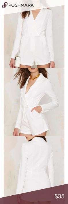 #62 nasty gal blazer of glory tux romper 🐥 Keep it luxe, keep it tux. The Blazer of Glory Romper comes in white and features double-breasted tuxedo design at top, front button and hidden zip closure, darted bust, pleated waist, front pockets, and romper design. Unlined. We love it paired with lace thigh-high socks and open-toe Mary Janes.  *Polyester  *Runs true to size  *Model is wearing size S  *Machine wash cold  *Imported Nasty Gal Pants Jumpsuits & Rompers