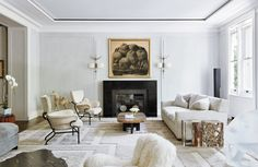 The living room in a Fifth Avenue apartment designed by Jacques Grange. A Fernando Botero still life hangs above a mica fireplace designed by Grange. Apartment Design, Bedroom Apartment, York Apartment, Best Interior, Interior Design, French Interior, Black And White Marble, All White Kitchen, Higher Design