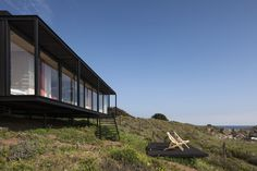 Built by Felipe Assadi in Pichicuy, Chile with date 2014. Images by Fernando Alda. This is the prototype of a transportable modular housing project. It is an 80 m2 house which was entirely built in th...