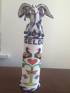 TURKISH HAND BEADED BEADWORK COLOGNE BOTTLE CASE WITH BIRD COVER. Made in a Turkish prison.