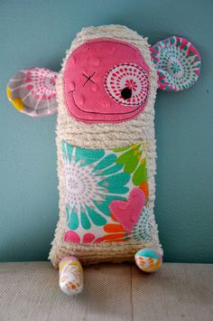 What a great idea. If you are NOT the sewing/crafty type, you can send in your cherished fabrics/keepsakes and have it made into a cute little stuffy monster.