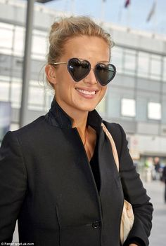 Sunny disposition: Model Petra Nemcova stepped out wearing heart-shaped sunglasses as she headed to Heathrow airport on Thursday Heart Shaped Sunglasses, Round Sunglasses, Petra Nemcova, For Your Eyes Only, Heart Shapes, Sunnies, Eyewear, Cool Photos, Detail