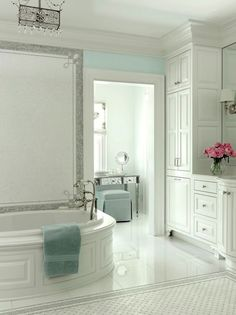 White cabinetry, #seafoam color scheme, and beautiful #tile selections