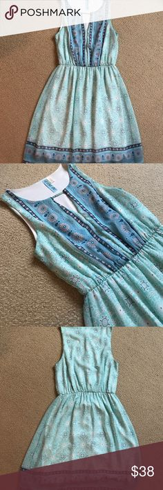 Blue boutique sundress Blue boutique sundress. Little keyhole in the front. Very cute on. New condition. Dresses Mini