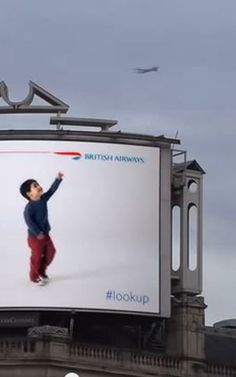 """BA #lookup campaign likely to win a ton of advertising awards in 2014. British Airways Digital Billboards Know When A Plane Is Flying Overhead. This stands out because the content gives the impression of """"reacting"""" to flights traveling overhead, but in actuality this would be no more difficult to execute than syncing the video and text displayed to a flight tracker app on a smartphone or mobile device. #Winning #InteractiveContent"""