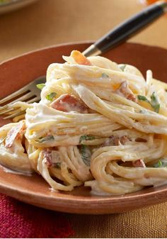 Spaghetti Carbonara – 20 minutes is all you need for simply delicious carbonara recipe. PHILADELPHIA Cream Cheese makes it, well, creamy; bacon, onion, Parmesan cheese, and zesty dressing add Italian restaurant-worthy flavor!
