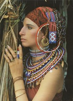 Barbra Streisand ... We share the same birthday, wish I had her talent and money.  :)