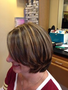 Short hair cut and style, covered up the gray hair with a rich brown and highlighted with a hint of red-brown and blonde