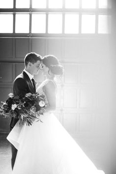 An absolutely breathtaking picture of the bride and groom. Photo by Melissa Oholendt Photography.