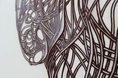 Berlin-based artist Max Gärtner produces intricate paper cutouts that have the quality of ink-drawn lines. Heads of jaguars, lionesses, and the wings of birds are all crafted using curvy bold marks that create contour, add visual weight, and define form. Large groups of lines wrap around each to imply textures like fur and feathers. So although Gärtner's works look flat, we get a great sense of how mighty and powerful these creatures are. From a distance, you might not be able to tell that…