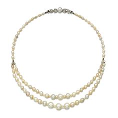 Natural pearl, emerald and diamond necklace The natural pearls measuring from approximately 2.8 to 9.4mm, to a clasp set with a circular-cut and rose diamonds and accented with mixed cut emeralds, shortest length approximately 455mm, one glass bead present.